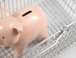 Close-up of piggy bank in shopping trolley