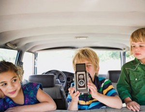Children in car with camera