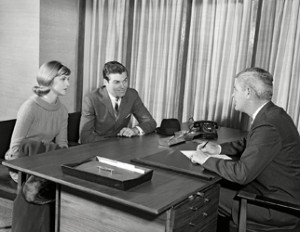 Young couple at desk meeting with businessman