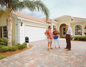 Alan Lulay, a sales consultant with Divosta/Pulte Homes, rig