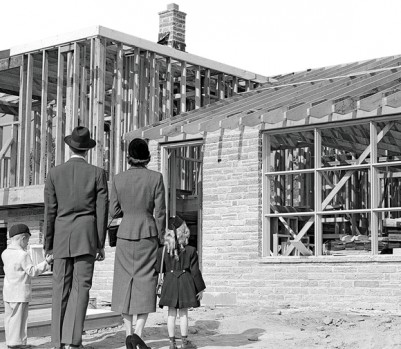 1950s Family Looking At New Home Under Construction