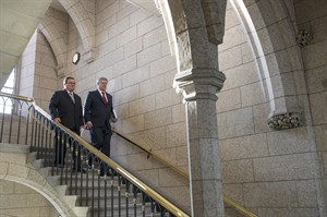 Prime Minister Stephen Harper arrives with Finance Minister Jim Flaherty as he enters the House of Commons to table the budget on Parliament Hill in Ottawa on Tuesday, Feb. 11, 2014. (THE CANADIAN PRESS/Justin Tang)