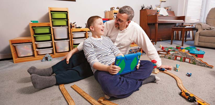 After figuring out the complex paperwork, Alan Whitton was able to set up an RDSP for his 8-year-old son Rhyse. (Photo by Blair Gable for MoneySense)