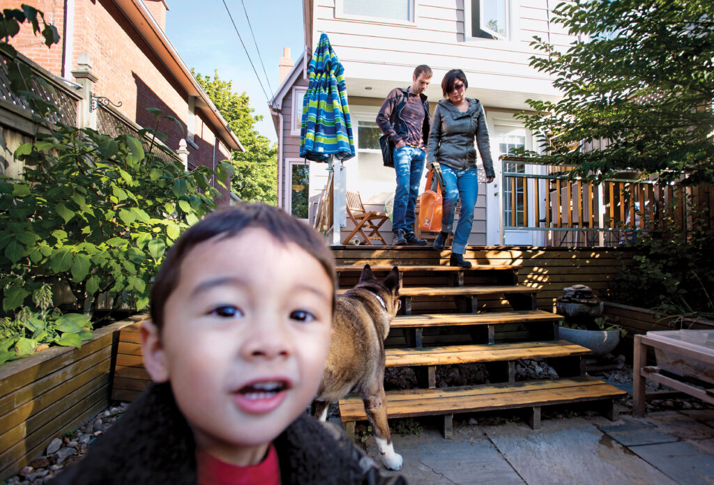 Morning ritual: Husband Kevin leaves for work as Tina Jones takes 3-year-old Leo to a local daycare in Toronto. (Photograph by Darren Calabrese)