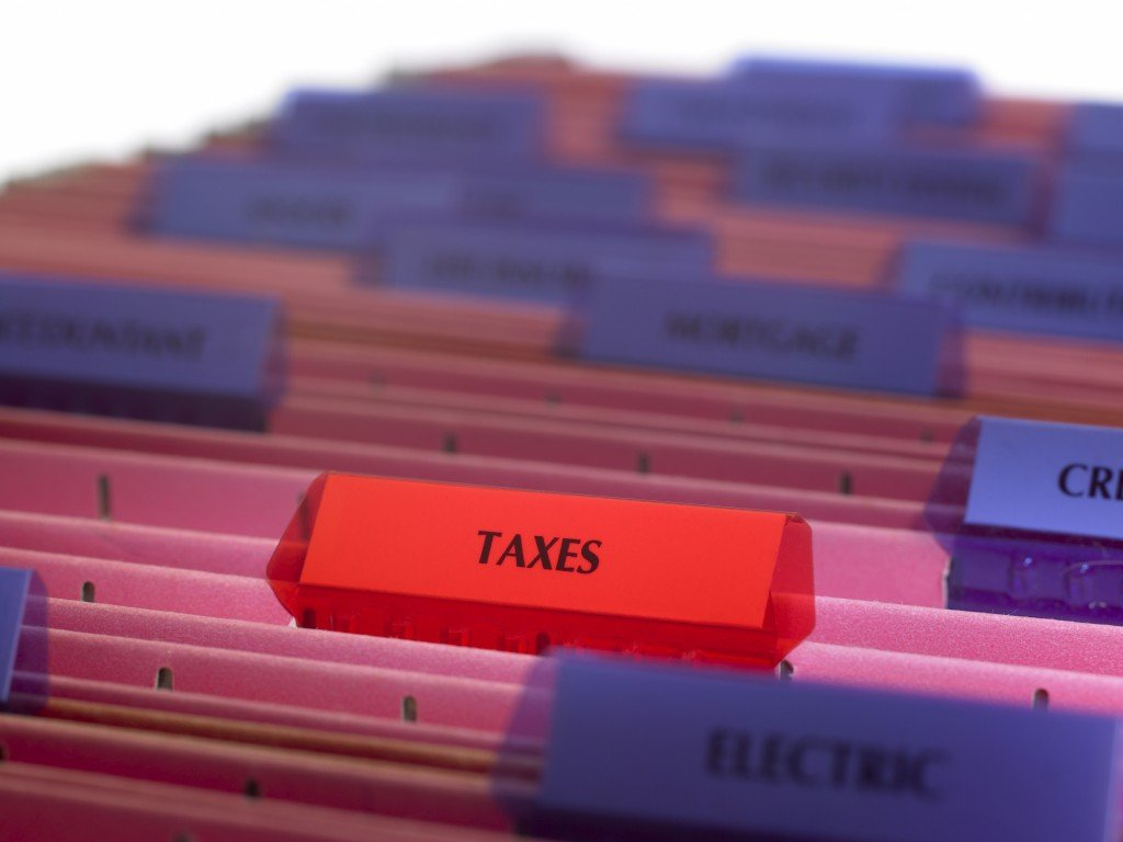 Real estate investors need to gather receipts at tax time (jonathansloane /Getty Images)