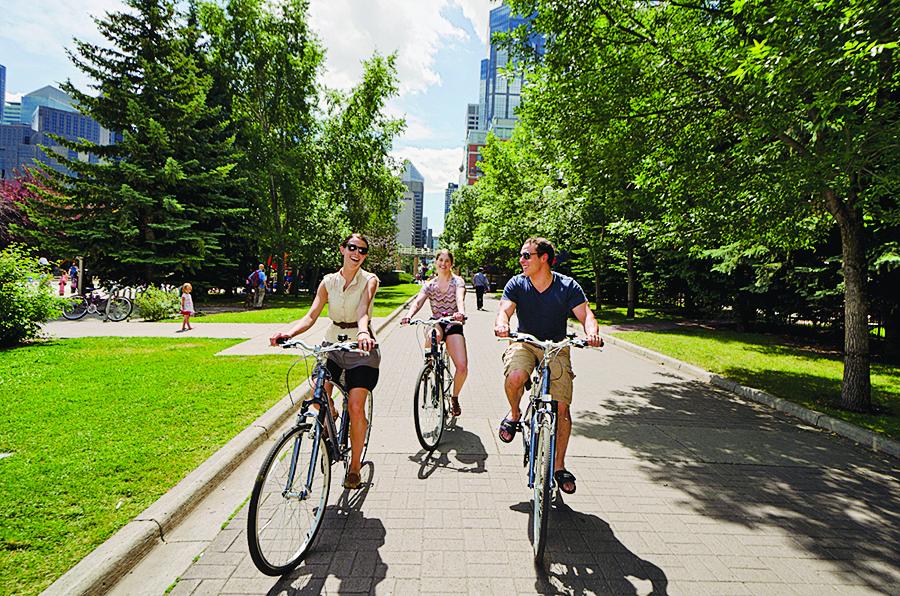 Eau Claire residents bike through Prince's Island Park (Tourism Calgary)