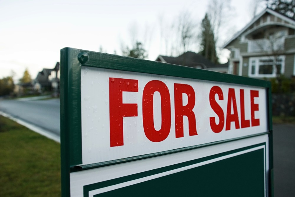 Buying property through tax sales (Getty Images / Image Source)