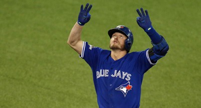 TORONTO, ON - OCTOBER 19:  Josh Donaldson #20 of the Toronto Blue Jays celebrates after hitting a two-run home run in the third inning against the Kansas City Royals during game three of the American League Championship Series at Rogers Centre on October 19, 2015 in Toronto, Canada.  (Photo by Vaughn Ridley/Getty Images)