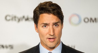 Liberal leader Justin Trudeau speaks to reporters during a press conference following the first federal leaders debate of the 2015 Canadian election campaign in Toronto,  August 6, 2015.  Canadians are set to go to the polls on October 19, 2015.    AFP PHOTO / GEOFF ROBINS        (Photo credit should read GEOFF ROBINS/AFP/Getty Images)