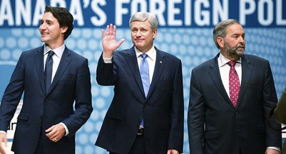 Liberal Leader Justin Trudeau, left to right, Conservative Leader and Prime Minister Stephen Harper and New Democratic Party Leader Thomas Mulcair look to the audience from the stage at the Munk Debate on Canada's foreign policy in Toronto, on Tuesday, September 28, 2015. (Mark Blinch/CP)