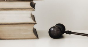 Judges gavel beside stacked law books (Tetra Images / Getty Images)