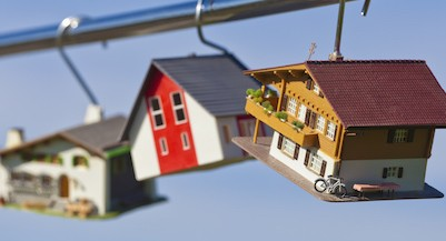 Germany, Baden Wuerttemberg, Stuttgart, House model hanging on steel rod (Westend61/Getty Images)