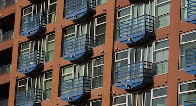 CALGARY, ALBERTA, CANADA - 2010:  A colorful new downtown highrise condominium apartment in Chinatown is seen in this 2010 Calgary, Canada, spring morning cityscape photo.  (Photo by George Rose/Getty Images)