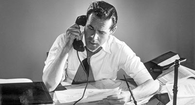 Businessman talking on the telephone in an office --- Image by © SuperStock/Corbis