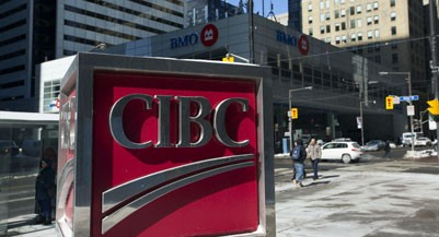 TORONTO, ON - FEBRUARY 25:  A CIBC logo sits kitty corner across from the BMO complex at King and Bay Streets in Toronto's financial district.        (Chris So/Toronto Star via Getty Images)