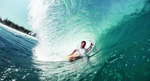 Bodyboarder Riding through tube wave, Puerto Rico, USA