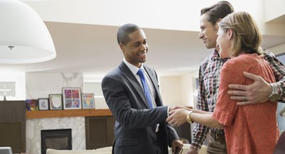 Couple shaking hands with financial advisor (hero images/getty images)