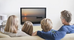 Family watching television, rear view