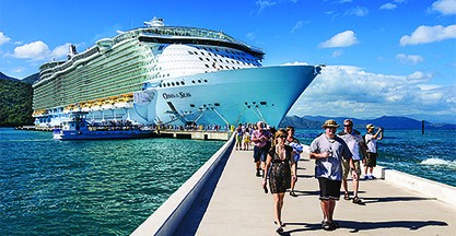 Passengers disembark the Royal Caribbean Cruise ship the Oasis of the Seas for a day of beach activities.  With a passenger capacity of over six thousand, the Oasis of the Seas is the largest cruise ship in the world to date.