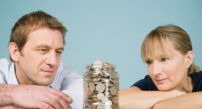 Couple looking at jar of coins