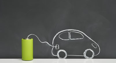 Batteries and electric  car vehicles on a blackboard (Yagi Studio/Getty Images)