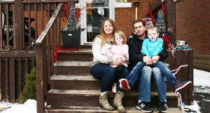 Shannon Jarrett and husband Marcin Duran sit with their children Charlotte, 2, and Maximus, 6, on the steps of their Hamilton home on February 19, 2016.
