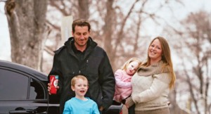 Marcin Duran and his wife Shannon Jarrett with their children Maximus, 6, and Charlotte, 2, with Marcin's Honda Civic outside their Hamilton home on February 19, 2016.
