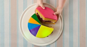 A child takes slice of a 'pie chart' cake.