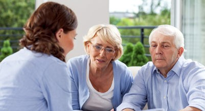 Senior couple talking with financial advisor (Izabela Habur/Getty Images)