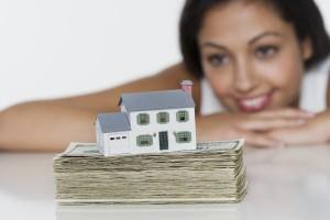 Woman looking at house savings