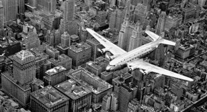 NEW YORK, UNITED STATES - 1939:  A view of a Douglas 4 (D-4) flying over Manhattan.  (Photo by Margaret Bourke-White/The LIFE Images Collection/Getty Images)
