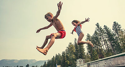 kids jumping off dock cottage season