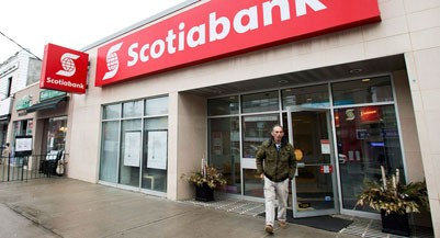 A man leaves Scotiabank in Toronto on Thursday, April 9, 2015. (Nathan Denette/CP)