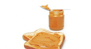 Peanut butter and toast, isolated on white