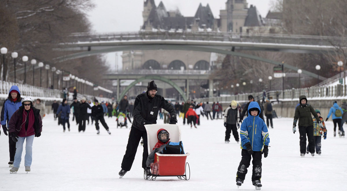 The Chateau Laurier is seen behind skaters on the the Rideau Canal Skateway on the first weekend of the National Capital Commission's Winterlude Festival in Ottawa, Saturday, Jan. 30, 2016. THE CANADIAN PRESS/Justin Tang