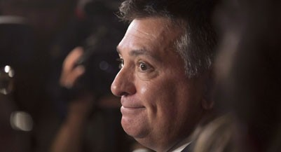 Ontario Finance Minister Charles Sousa smiles while speaking to the media following the Speech from the Throne, opening the second session of the 41st Parliament of Ontario, in Toronto on Monday, Sept. 12, 2016. THE CANADIAN PRESS/Peter Power