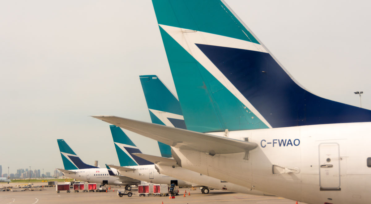 TORONTO, ONTARIO, CANADA - 2014/06/23: Westjet plane tails in Pearson International Airport. Westjet is an economical Canadian Airline serving mostly tourist destinations. (Photo by Roberto Machado Noa/LightRocket via Getty Images)