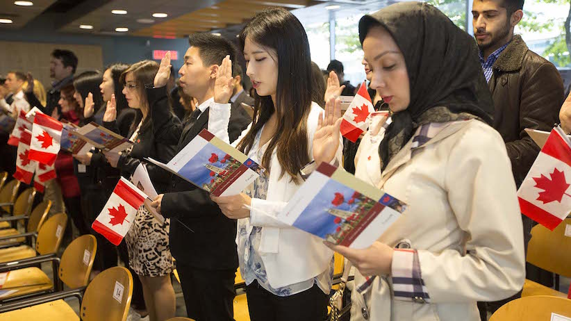 Oct 6 2015--Vancouver BC--Citizenship ceremony: New Canadians take the citizenship oath during a ceremony in Vancouver.(Photographs by Brian Howell)