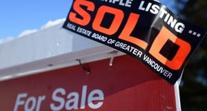 A real estate sold sign is shown outside a house in Vancouver, Tuesday, Jan.3, 2017. The British Columbia Real Estate Association says a lack of homes on the market means buyers are paying more for housing across the province.THE CANADIAN PRESS/Jonathan Hayward