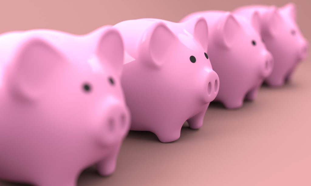 piggy banks lined up in a row