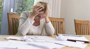 Woman worried about financial problems. paying taxes