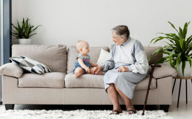a grandmother and grandchild on a couch