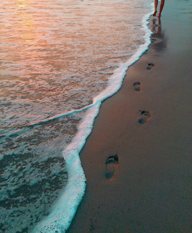 beach footsteps walking towards retirement