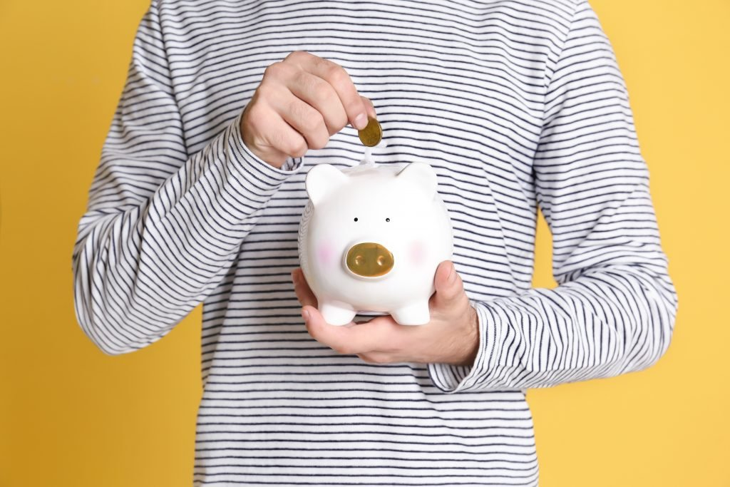 young person piggy bank
