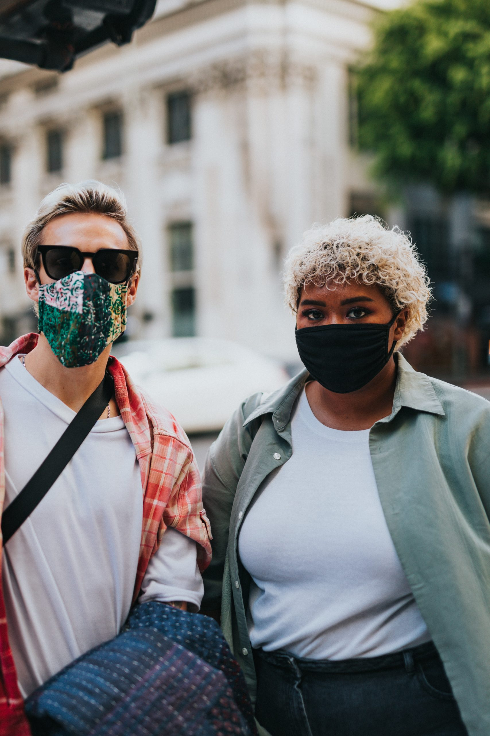 two young people wearing fabric face masks