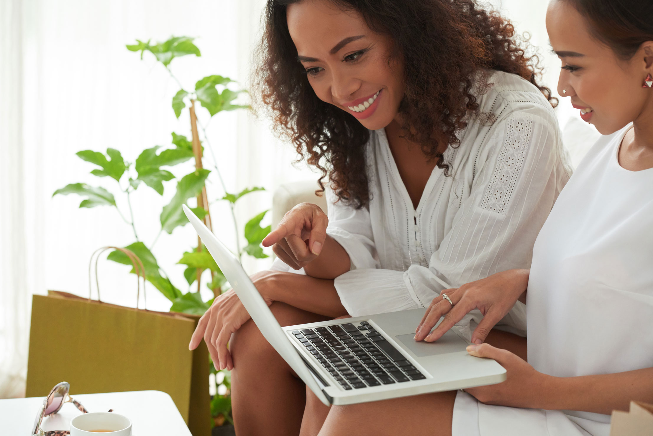 Two women researching the best TD credit cards online