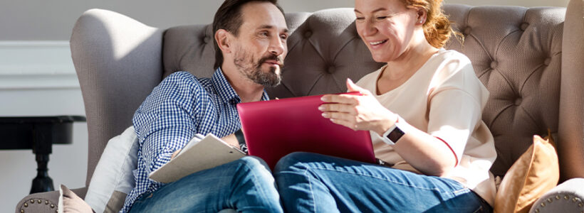 Couple discussing investments over their tablet