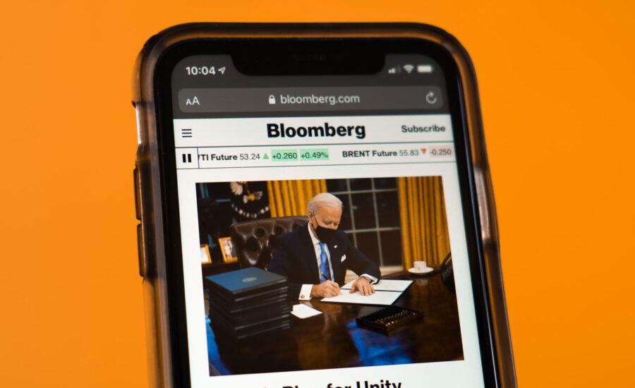 A cellphone with a Joe Biden article.