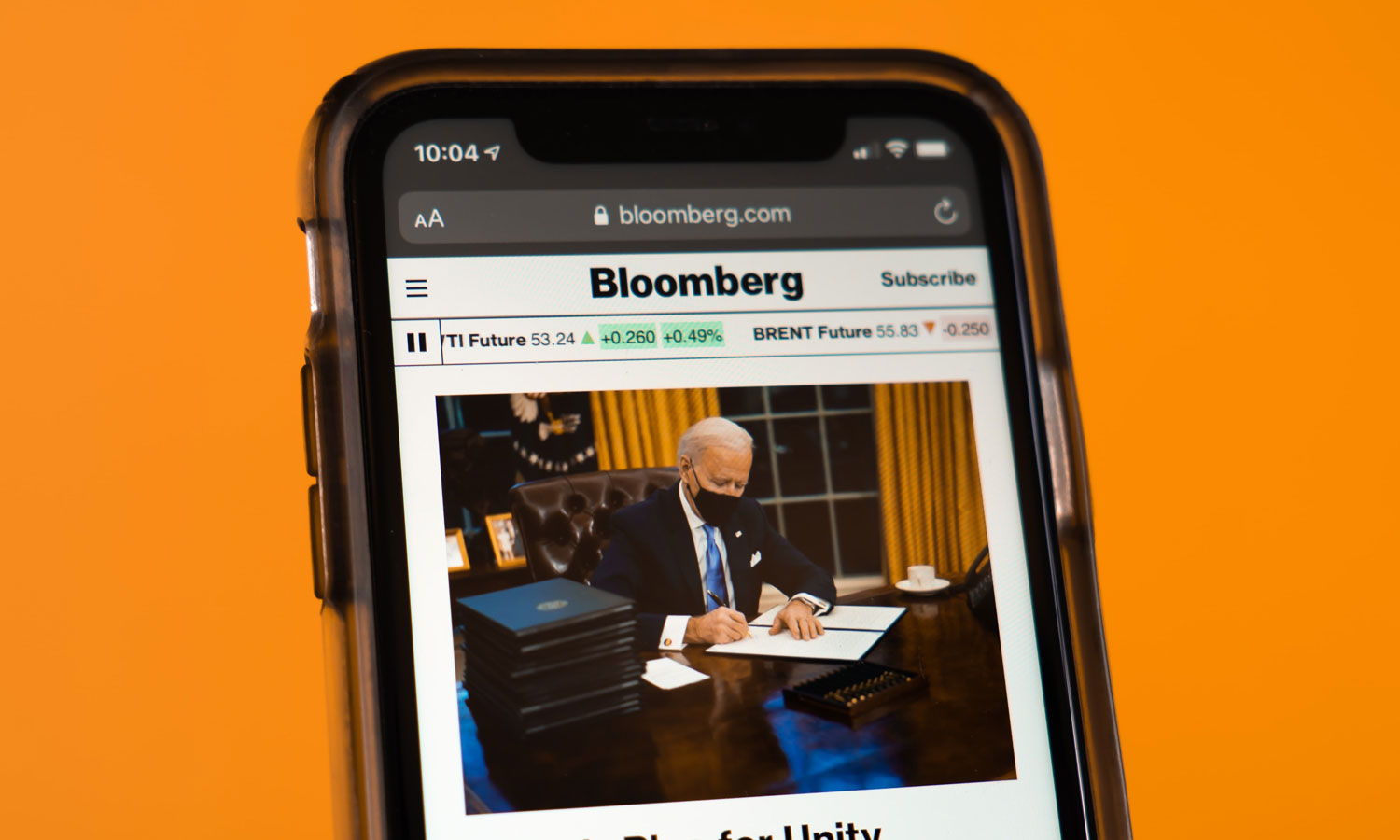 A cellphone with a Joe Biden article.