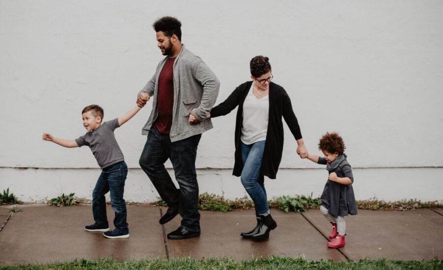 young family walking hand-in-hand